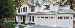 white home with garage doors